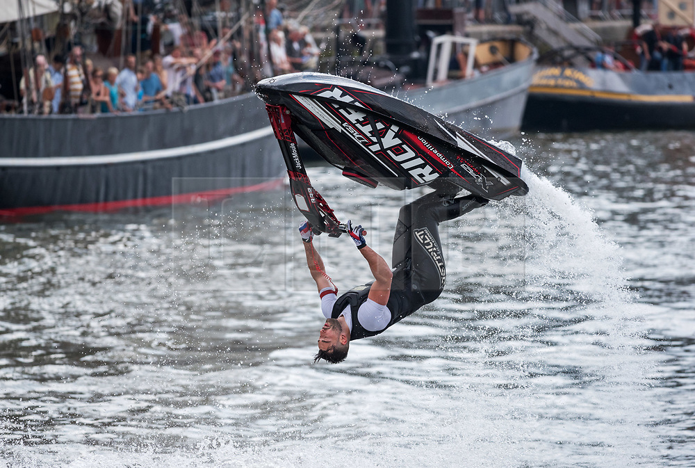 © Licensed to London News Pictures.  21/07/2018; Bristol, UK. Bristol Harbour Festival. JACK MOULE does stunts on a jetski for the crowds. People enjoy the good weather during the Bristol Harbour Festival in the city centre of Bristol. Bristol Harbour Festival is a 3 day extravaganza of dance, music, theatre, circus, ships and boats, arts and delicious food. The festival is free for all and brings over 250,000 people together each summer to celebrate Bristol's rich maritime history and enjoy some of the city's best music and entertainment. The festival takes place on the  20 - 22 July 2018. Photo credit: Simon Chapman/LNP