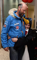 Ed Parker, Co-Founder of Walking with the Wounded and Team Mentor returns home to be greeted by his daughter Olivia ,11, dressed up as a penguin.<br /> The Walking With the Wounded South Pole Allied Challenge 2013 teams return to Heathrow Airport after successfully reaching the South Pole.<br />  Monday, 23rd December 2013. Picture by Ben Stevens / i-Images