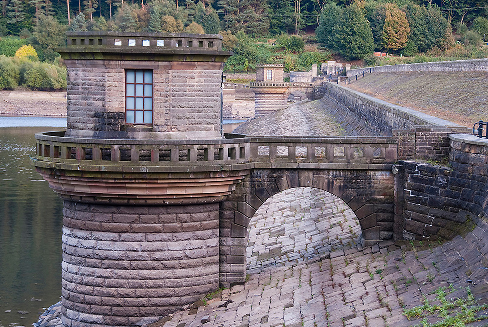 DERBYSHIRE UK - 06 Oct : Ladybower reservoir dam head wall path and draw off tower exposed by low water level on 06 Oct 2013 in the Peak District, UK