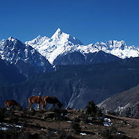 "MEILI MOUNTAIN, DECEMBER 17, 2000: a view of Mt. Meili ( Mt. Meilixue ) , the highest peak in Yunnan province, in Deqin county, Yunnan province , December 17, 2000..Mt. Meili is the highest peak in Yunnan province and according to supporters from Deqin county, it's a ""proof"" that the 'real"" Shangri-La is located in deqin county. The fictuous Mt. Karakal which is described in James Hilton's Lost Horizon, alledgedly is modelled on Mt. Meili in Yunnan province.."