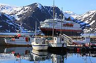 Hurtigruten coastal cruise ship, Kong Harald, departs from Honningsvag, Norway.