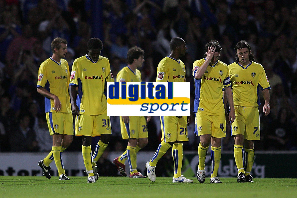 Photo: Lee Earle.<br /> Portsmouth v Leeds United. Carling Cup. 28/08/2007.The Leeds players look dejected after Portsmouth scored their first.