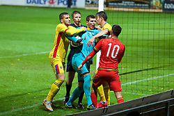 WREXHAM, WALES - Tuesday, November 17, 2015: Romania's goalkeeper Laurentiu Branescu is held back by team-mates and the referee Mitja Zganec after he assaulted Wales' Thomas O'Sullivan and is subsequently shown a red card and sent off during the UEFA Under-21 Championship Qualifying Group 5 match at the Racecourse Ground. (Pic by David Rawcliffe/Propaganda)2