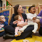 Scottish Labour leader visits nursery. Kezia Dugdale during a visit to Castlemilk Stables nursery in Glasgow to mark the deadline John Swinney set for Scottish councils to meet new funding deal. With children Blake McMillan(L), holding Marabelle O'Hanlon (C) and  a crying Charis Chaps (R). Picture Robert Perry 9th Jan 2016<br /> <br /> Must credit photo to Robert Perry<br /> FEE PAYABLE FOR REPRO USE<br /> FEE PAYABLE FOR ALL INTERNET USE<br /> www.robertperry.co.uk<br /> NB -This image is not to be distributed without the prior consent of the copyright holder.<br /> in using this image you agree to abide by terms and conditions as stated in this caption.<br /> All monies payable to Robert Perry<br /> <br /> (PLEASE DO NOT REMOVE THIS CAPTION)<br /> This image is intended for Editorial use (e.g. news). Any commercial or promotional use requires additional clearance. <br /> Copyright 2014 All rights protected.<br /> first use only<br /> contact details<br /> Robert Perry     <br /> 07702 631 477<br /> robertperryphotos@gmail.com<br /> no internet usage without prior consent.         <br /> Robert Perry reserves the right to pursue unauthorised use of this image . If you violate my intellectual property you may be liable for  damages, loss of income, and profits you derive from the use of this image.