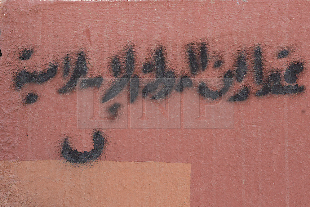 Licensed to London News Pictures. 23/10/2016. A stencil, left by militants, declares a former Christian house in the town of Bartella, Iraq, to be the property of the Islamic State<br /> <br /> Bartella, a mainly Christian town with a population of around 30,000 people before being taken by the Islamic State in August 2014, was captured two days ago by the Iraqi Army's Counter Terrorism force as part of the ongoing offensive to retake Mosul. Although ISIS militants were pushed back a large amount of improvised explosive devices are still being found in the town's buildings. Photo credit: Matt Cetti-Roberts/LNP