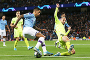 Manchester City defender Joao Cancelo (27) turns Dinamo Zagreb defender Marin Leovac (22) during the Champions League match between Manchester City and Dinamo Zagreb at the Etihad Stadium, Manchester, England on 1 October 2019.