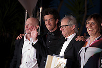 Screenwriter Paul Laverty, cinematographer Robbie Ryan, Director Ken Loach, producer Rebecca O'Brien, with the award Palme D'or   I, Daniel Blake<br /> at the Palm D'Or Winners photocall at the 69th Cannes Film Festival Sunday 22nd May 2016, Cannes, France. Photography: Doreen Kennedy