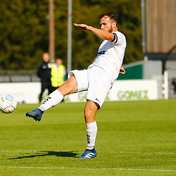 Dovers midfielder Mitch Brundle hits the ball to score and bring the hosts back to within a goal during the National League match between Dover Athletic FC and Eastleigh FC at Crabble Stadium, Kent on 25 August 2018. Photo by Matt Bristow.