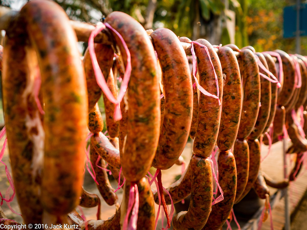 11 MARCH 2016 - LUANG PRABANG, LAOS:  Lao sausage dries in the sun in Luang Prabang, Laos. Laos is one of the poorest countries in Southeast Asia. Tourism and hydroelectric dams along the rivers that run through the country are driving the legal economy.     PHOTO BY JACK KURTZ