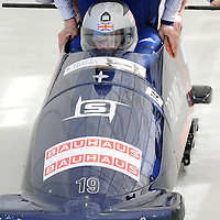 28 February 2007:    The Great Britain 1 bobsled driven by Lee Johnston with sidepushers Karl Johnston and Dan Money, and brakeman  Allyn Condon jump into the sled at the start of the 2nd run at the 4-Man World Championships competition on February 27 at the Olympic Sports Complex in Lake Placid, NY.