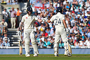 Ben Stokes of England and Joe Denly of England touch gloves during the 5th International Test Match 2019 match between England and Australia at the Oval, London, United Kingdom on 14 September 2019.