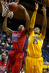 March 16, 2011; Berkeley, CA, USA;  Mississippi Rebels forward Steadman Short (15) grabs a rebound in front of California Golden Bears forward Richard Solomon (25) during the second half of the first round of the National Invitation Tournament at Haas Pavilion.  California defeated Mississippi 77-74.