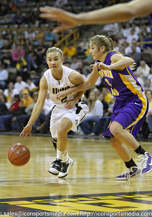 December 22 2010: Iowa guard Kamille Wahlin (2) works against Northern Iowa guard Rachel Madrigal (3) during the first half of an NCAA college basketball game at Carver-Hawkeye Arena in Iowa City, Iowa on December 22, 2010. Iowa defeated Northern Iowa 75-64.