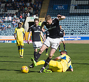 21st April 2018, Dens Park, Dundee, Scotland; Scottish Premier League football, Dundee versus St Johnstone; Chris Millar of St Johnstone tackles Kevin Holt of Dundee