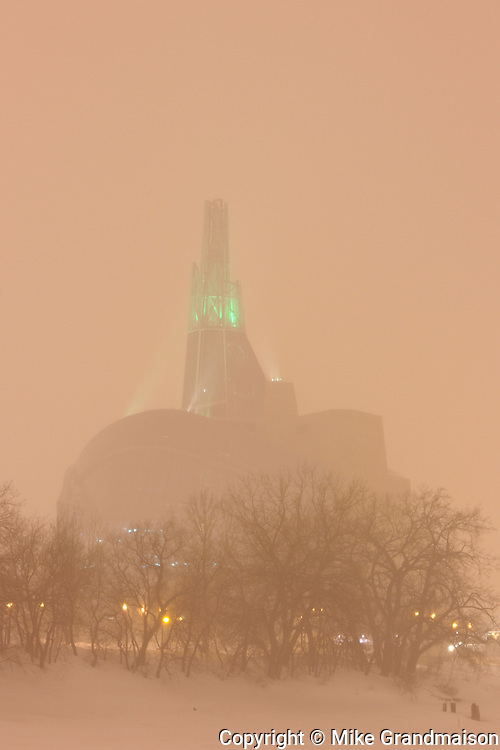 Canadian Museum for Human Rights with the 'Tower of Hope' glowing GREEN for St. Patrick's Day Celebrations.<br /> Winnipeg<br /> Manitoba<br /> Canada