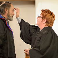 020114       Cayla Nimmo<br /> <br /> Pastor Lorelei Kay imposes ashes on the forehead of Tim Knowles during the Ash Wednesday service held at Westminster Presbyterian Church to begin the Christian season of Lent.