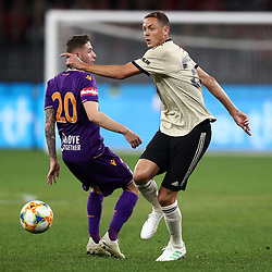 Nemanja Matic of Manchester United gets past Jake Brimmer of Perth Glory