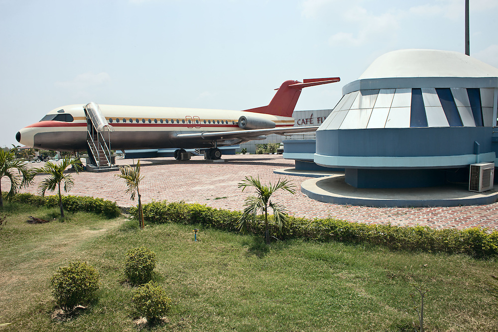 The plane is a real one that crashed sometime ago and it was eventually converted into a bar called Cafe Flight. Sky Palace Hotel & Cafe Flight is one of the first a hotels in the new capital. Sky Palace Hotel is owned by Mann Pyi Dagon Company Ltd. Nap Pyi Taw, Myanmar. 2012