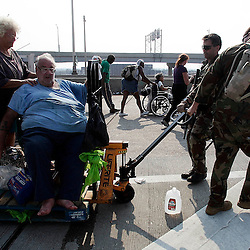 Victim's of the hurricane who cannot walk are carried on a dolly to a helicopter to be taken to a shelter during the aftermath of Hurricane Katrina Saturday, September 3, 2005 in New Orleans, Louisiana.  <br /> (Pasadena Star-News Keith Birmingham)