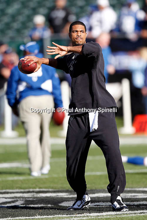 Oakland Raiders quarterback Jason Campbell (8) throws a pregame pass during the NFL week 16 football game against the Indianapolis Colts on Sunday, December 26, 2010 in Oakland, California. The Colts won the game 31-26. (©Paul Anthony Spinelli)