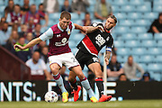 Aston Villa   midfielder Gary Gardner (22) and Nottingham Forest midfielder Henri Lansbury (10)  during the EFL Sky Bet Championship match between Aston Villa and Nottingham Forest at Villa Park, Birmingham, England on 11 September 2016. Photo by Simon Davies.