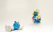 Smurf figurines on white background Smurf and Smurfette
