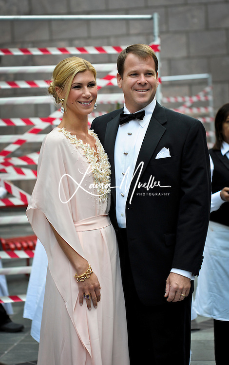 20121020 As the most exclusive event in Charlotte, the Opera Carolina Bella Notte Gala is the most highly anticipated event of the social season. The event is by invitation only with limited reservations. Hosted by Barrie and Matt Benson, the evening will be staged among the set of Puccini's ?Tosca.? This formal, black-tie event turns out some of Charlotte's best-dressed, .Photo by Laura Mueller.www.lauramuellerphotography.com