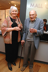 JUNE CROWN and hr husband SIDNEY CROWN at an exhibition of Tess Barnes's work '50 Women of Substance' sponsored by First Direct in aid of Breast Cancer Haven held at The Mall Gallery, London on 26th February 2008.<br />