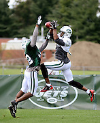 New York Jets Braylon Edwards, right, makes the catch despite the attempted block by Josh Bush during a practice at the Jets training camp in Cortland, NY, Monday, August 5, 2013. (Heather Ainsworth for The New York Times)