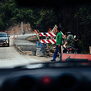 A one-way road construction stop near Chiang Mai, Thailand on our way to ride the Mae Wang Trail.
