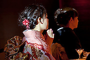 young adult woman in the traditional formal furisode style kimono dress for unmarried women with mother