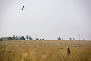 Alex Koekzenko, working with volunteer organization Victory Sisters, is landing an unmanned surveillance aircraft, (drone) being used in collaboration with the Ukrainian army and patriotic volunteers' groups, to collect visual information over pro-Russia separatists' positions, in an undisclosed location near the village of Berdyans'ke, 2 km from the frontline town Shyrokine, southeast Ukraine.
