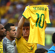 David Luiz of Brazil holds up the shirt of injured team mate, Neymar Jr.  during the 2014 FIFA World Cup match at Mineir&atilde;o, Belo Horizonte<br /> Picture by Stefano Gnech/Focus Images Ltd +39 333 1641678<br /> 08/07/2014