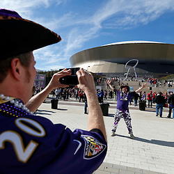 Feb 3, 2013; New Orleans, LA, USA; Baltimore Ravens fan Gary Siegler gets his photo taken by Mike Schleifer (left) before Super Bowl XLVII against the .San Francisco 49ers at the Mercedes-Benz Superdome. Mandatory Credit: Derick E. Hingle-USA TODAY Sports