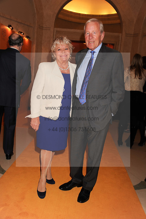 JUDITH CHALMERS and NEIL DURDEN-SMITH at the annual Veuve Clicquot Business Woman of the Year Award this year celebrating it's 40th year, held at Claridge's, Brook Street, London on 18th April 2012.