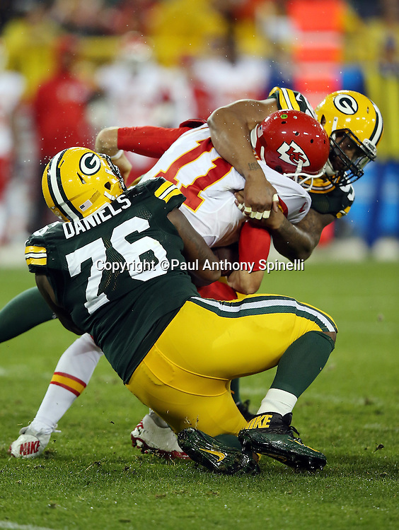 Green Bay Packers defensive end Mike Daniels (76) and Green Bay Packers outside linebacker Mike Neal (96) sack Kansas City Chiefs quarterback Alex Smith (11) in the third quarter during the 2015 NFL week 3 regular season football game against the Kansas City Chiefs on Monday, Sept. 28, 2015 in Green Bay, Wis. The Packers won the game 38-28. (©Paul Anthony Spinelli)