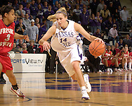 Kansas State's Claire Coggins (R) drives against Fresno State's Tierre Wilson (L), during the second half at Bramlage Coliseum in Manhattan, Kansas, March 22, 2006.  K-State defeated the Bulldogs 64-61 in the second round of the WNIT.