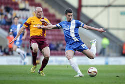 Peterborough United's Tommy Rowe in action with Bradford City's Gary Jones  - Photo mandatory by-line: Joe Dent/JMP - Mobile: 07966 386802 18/04/2014 - SPORT - FOOTBALL - Bradford - Valley Parade - Bradford City v Peterborough United - Sky Bet League One