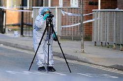 © Licensed to London News Pictures. 06/05/2018. LONDON, UK.  A member of the forensics team at work inside the cordon on Palmerston Road in Wealdstone, near Harrow, north west London, following reports of two separate shooting incident around midday on Sunday 6 May 2018.  The two victims are a 12 year old boy and a15 year old boy.  Investigations are ongoing.  Photo credit: Stephen Chung/LNP