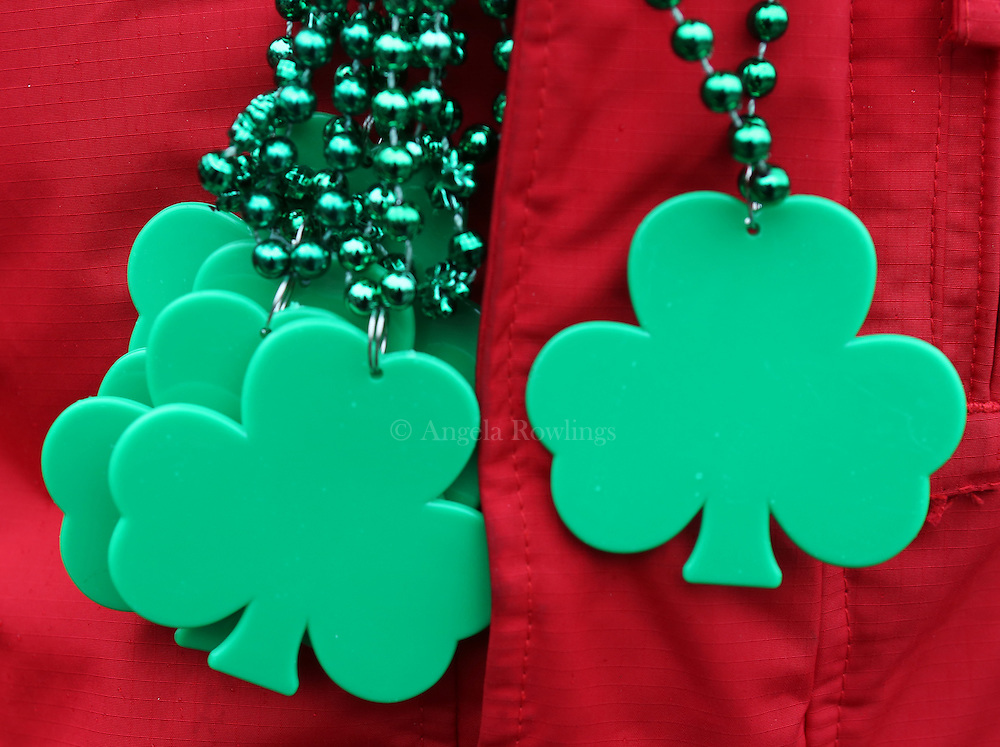 (Boston, MA - 3/15/15) Shamrock necklaces hang from the neck of a parade-goer during the St. Patrick's Day Parade in South Boston, Sunday, March 15, 2015. Staff photo by Angela Rowlings.