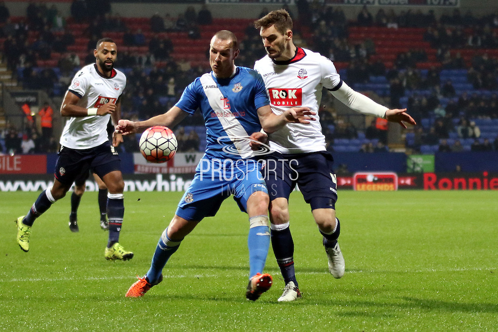 Dorian Dervite challenges during the The FA Cup Third Round Replay match between Bolton Wanderers and Eastleigh at the Macron Stadium, Bolton, England on 19 January 2016. Photo by Pete Burns.
