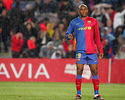 Samuel Eto'o of Barcelona stands in the heavy rain during the UEFA Champions League quarter final first leg match between FC Barcelona and FC Bayern Munich at the Camp Nou stadium on April 8, 2009 in Barcelona, Spain.