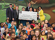L-R: Houston ISD Superintendent Dr. Terry Grier, Steven Shetzer, Marty Daniel, Cameron Wilson and Trustee Paula Harris pose with students and a check awarded to Kolter Elementary School by Code.org for the Hour of Code, December 10, 2014.