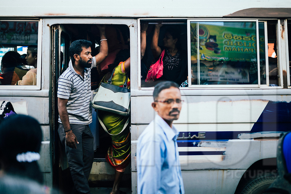 Commuters in a bus in the late afternoon at the central market downtown Jaffna, Sri Lanka, Asia