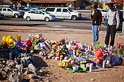 "15 JANUARY 2010 - TUCSON, AZ:    People visit the memorial for Congresswoman GABRIELLE GIFFORDS and others shot Sat. Jan. 8 at the intersection of Ina and Oracle Roads in Tucson, AZ, Saturday, January 15. Six people were killed and 14 injured in the shooting spree at a ""Congress on Your Corner"" event hosted by Arizona Congresswoman Gabrielle Giffords at a Safeway grocery store in north Tucson on January 8. Congresswoman Giffords, the intended target of the attack, was shot in the head and seriously injured in the attack but is recovering. Doctors announced that they removed her breathing tube Saturday, one week after the attack. The alleged gunman, Jared Lee Loughner, was wrestled to the ground by bystanders when he stopped shooting to reload the Glock 19 semi-automatic pistol. Loughner is currently in federal custody at a medium security prison near Phoenix.  PHOTO BY JACK KURTZ"