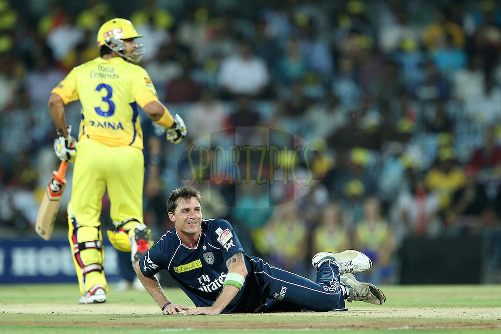Dale Steyn falls down after delivering the ball as Faf du Plessis and Suresh Raina make the the run during match 46 of the the Indian Premier League ( IPL) 2012  between The Chennai Superkings and the Deccan Chargers held at the M. A. Chidambaram Stadium, Chennai on the 4th May 2012..Photo by Ron Gaunt/IPL/SPORTZPICS