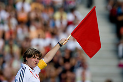Referee with red flag during the men's Javelin Throw Final during day nine of the 12th IAAF World Athletics Championships at the Olympic Stadium on August 23, 2009 in Berlin, Germany. (Photo by Vid Ponikvar / Sportida)