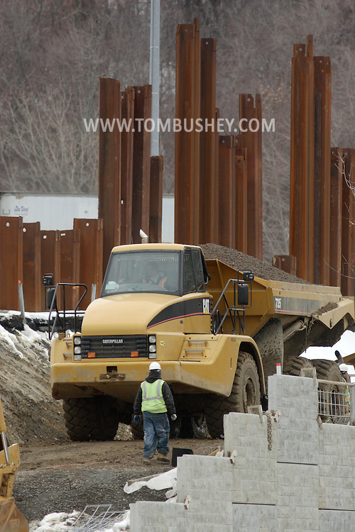 Town of Newburgh, NY - A worker walks toward a dump truck as construction continues on the new Interstate 84-Interstate 87 interchange project on Feb. 27, 2008. Currently there is no direct connection between the two highways. The project is expected to be complete in the fall of 2009.