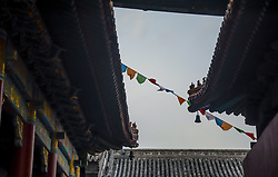 August 9, 2017 - Beijing, Beijing, China - Beijing, CHINA-August 9 2017: (EDITORIAL USE ONLY. CHINA OUT) ..The Yonghe Temple, also known as the Yonghe Lamasery, or popularly as the Lama Temple, is a temple and monastery of the Gelug school of Tibetan Buddhism located in Dongcheng District, Beijing, China. The building and artwork of the temple is a combination of Han Chinese and Tibetan styles. (Credit Image: © SIPA Asia via ZUMA Wire)
