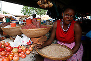 Omuhereza Kumihira working on vegetable stall. Hoima main Market. Western Uganda. Africa.